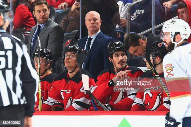Head Coach John Hynes of the New Jersey Devils looks on during the game against the Florida Panthers at Prudential Center on November 27 2017 in...
