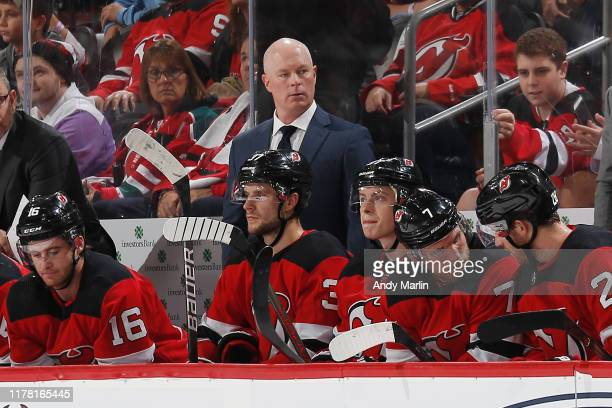 Head Coach John Hynes of the New Jersey Devils looks on from behind the bench during the game against the Arizona Coyotes at the Prudential Center on...