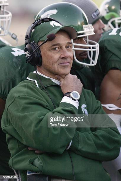 Head coach John L. Smith of the Michigan State Spartans looks on while facing the Wisconsin Badgers during the game at Spartan Stadium on November...