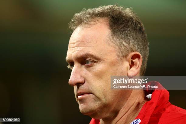 Head coach John Longmire of the Swans walks off the field prior to the round 18 AFL match between the Sydney Swans and the St Kilda Saints at Sydney...
