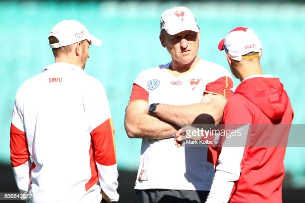 Head coach John Longmire speaks to his staff during a Sydney Swans AFL training session at Sydney Cricket Ground on August 22 2017 in Sydney Australia
