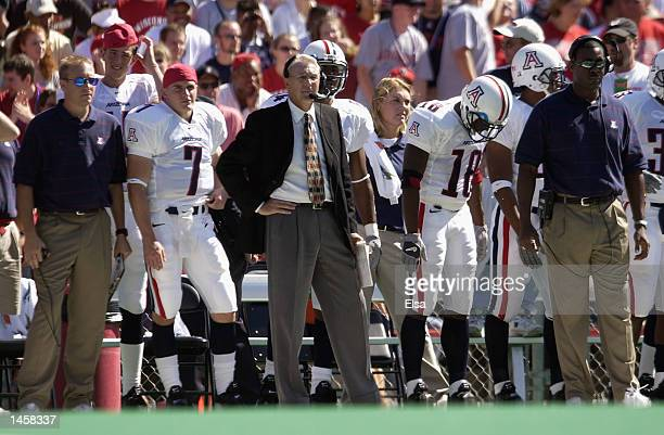 Head coach John Mackovic of the Arizona Wildcats stands on the sideline during the NCAA football game against the Wisconsin Badgers on September 21...