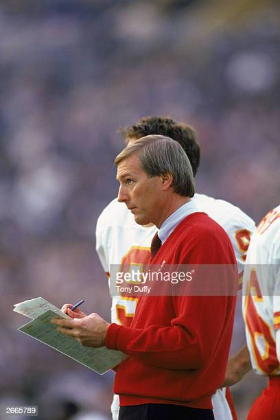 Head coach John Mackovic of the Kansas City Chiefs reviews his playsheet during a 1986 NFL game against the Los Angeles Raiders at the LA Memorial...