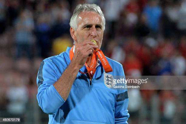 Head coach John Peacock of England kisses the winner's medal after winning the UEFA Under17 European Championship 2014 final match against...