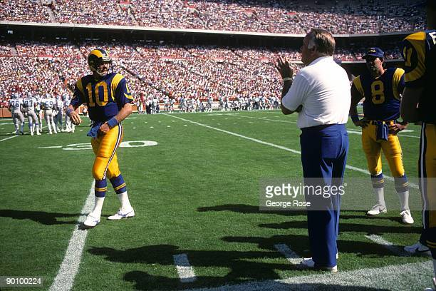 Head coach John Robinson of the Los Angeles Rams instructs his quarterback Steve Bartkowski during the game against the Detroit Lions at Anaheim...