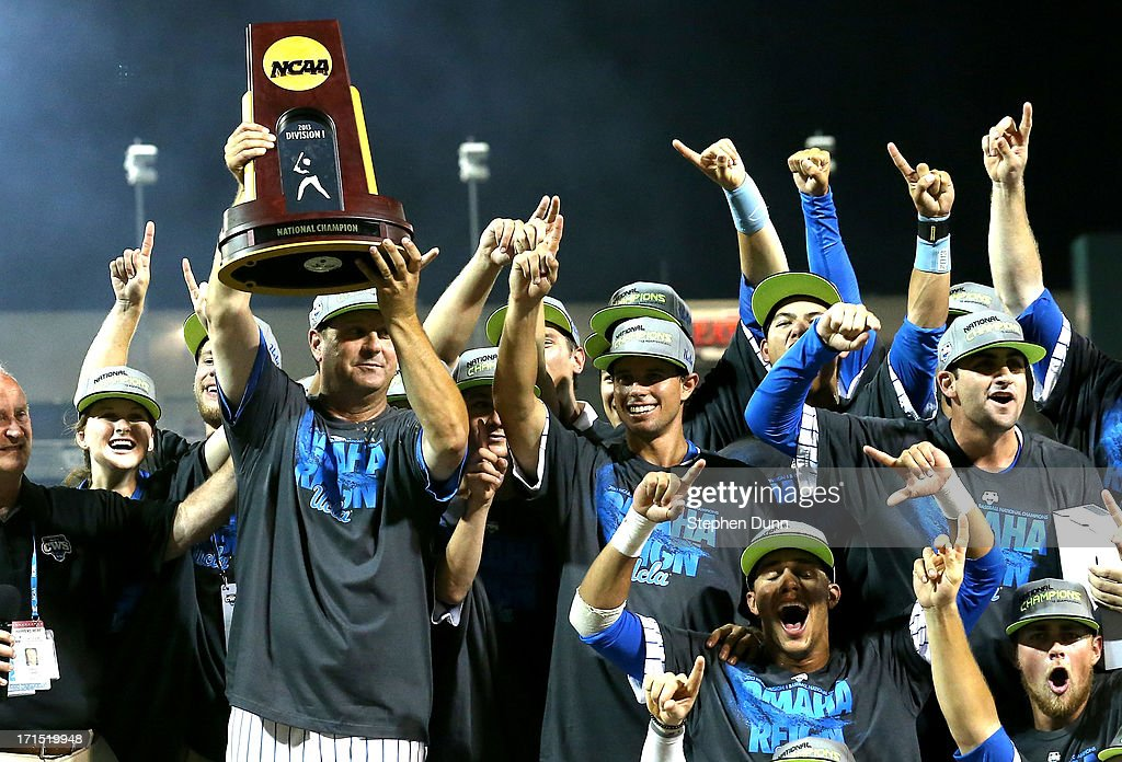 Head coach John Savage of the UCLA Bruins holds up the championship trophy after UCL defeated the Mississippi State Bulldogs during game two of the College World Series Finals on June 25, 2013 at TD Ameritrade Park in Omaha, Nebraska. UCLA won 8-0 to take the series two games to none and win the College World Series Championship.