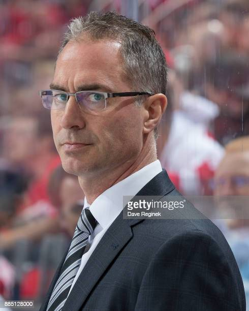 Head coach John Stevens of the Los Angeles Kings watches the action from the bench against the Detroit Red Wings during an NHL game at Little Caesars...