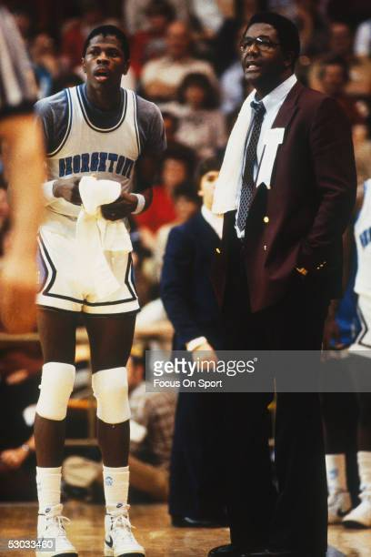 Head coach John Thompson of the Georgetown Hoyas talks with Patrick Ewing during a time out
