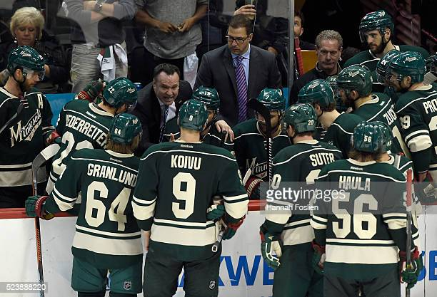 Head coach John Torchetti of the Minnesota Wild speaks to his players during a timeout in the third period against the Dallas Stars of Game Six of...