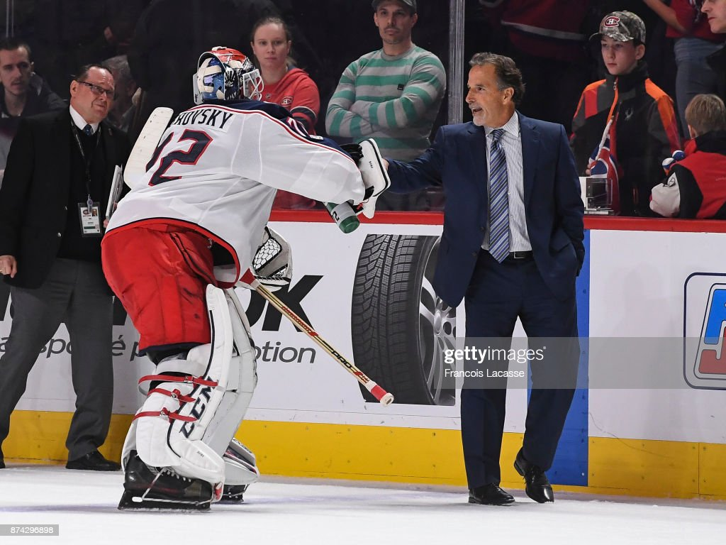 Head coach John Tortorella of the Columbus Blue Jackets celebrates with goalkeeper Sergei Bobrovsky #72 the victory over the Montreal Canadiens in the NHL game at the Bell Centre on November 14, 2017 in Montreal, Quebec, Canada.