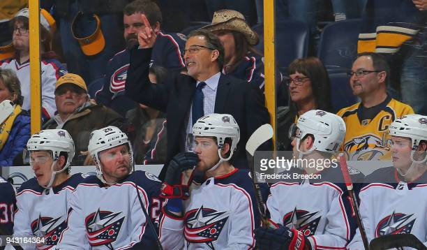 Head coach John Tortorella of the Columbus Blue Jackets points to the jumbotron in protest after giving up a goal to the Nashville Predators with one...