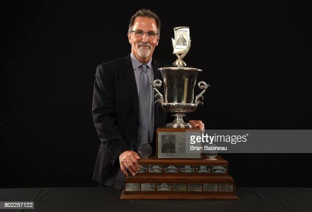Head coach John Tortorella of the Columbus Blue Jackets poses for a portrait with the Jack Adams Award at the 2017 NHL Awards at TMobile Arena on...