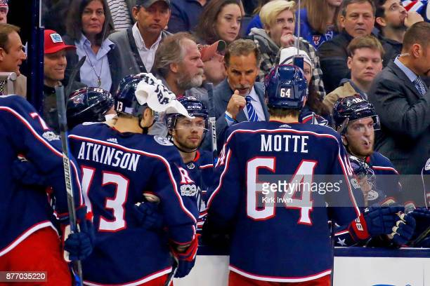 Head coach John Tortorella of the Columbus Blue Jackets talks with Tyler Motte of the Columbus Blue Jackets during a timeout in the game against the...
