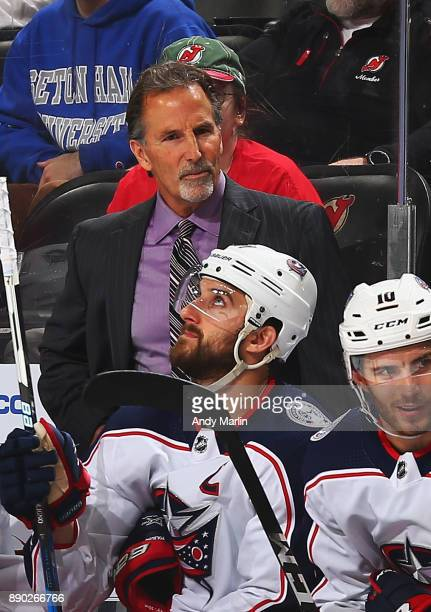 Head Coach John Tortorella of the Columbus Blue Jackets talks with his team during the game against the New Jersey Devils at Prudential Center on...
