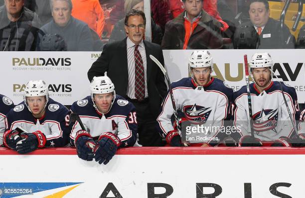 Head Coach John Tortorella of the Columbus Blue Jackets watches the play on the ice behind Artemi Panarin Boone Jenner Alexander Wennberg and Oliver...