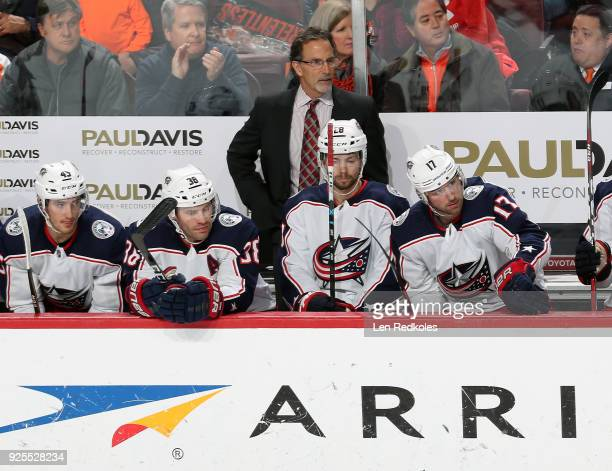 Head Coach John Tortorella of the Columbus Blue Jackets watches the play on the ice behind Lukas Sedlak Boone Jenner Oliver Bjorkstand and Brandon...