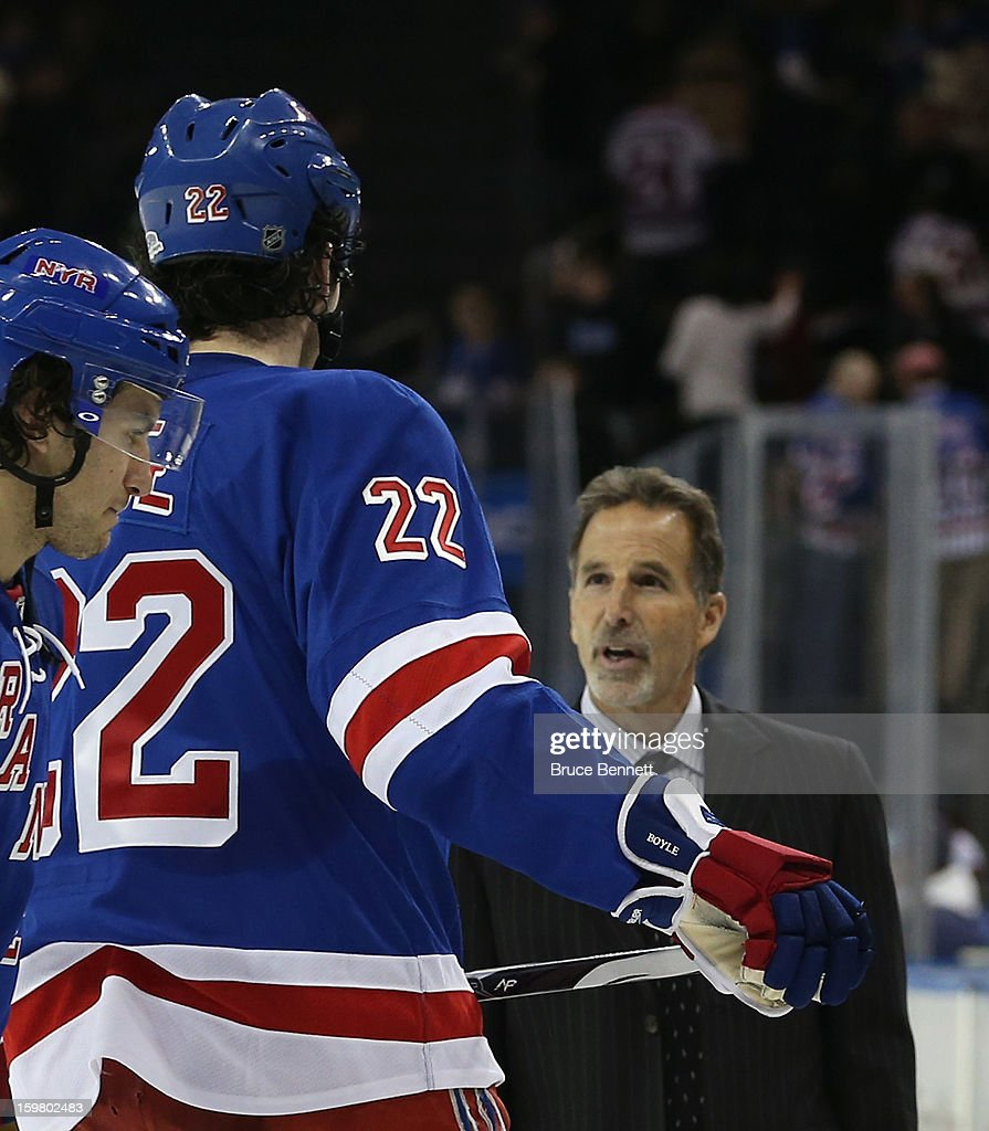 Head coach John Tortorella of the New York Rangers speaks with Brian Boyle #22 following a 6-3 loss to the Pittsburgh Penguins at Madison Square Garden on January 20, 2013 in New York City.