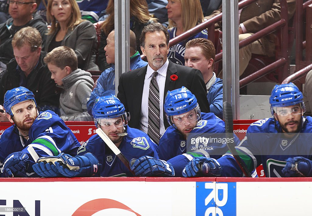 Head coach John Tortorella of the Vancouver Canucks looks on from the bench during their NHL game against the Detroit Red Wings at Rogers Arena on October 30, 2013 in Vancouver, British Columbia, Canada. Detroit won 2-1.
