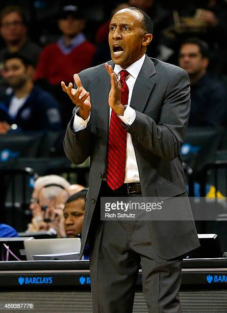 Head coach Johnny Dawkins of the Stanford Cardinal cheers his team on during the second half of a game against of the UNLV Rebels in the Coaches vs...