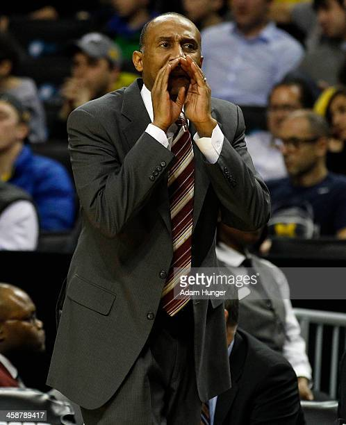 Head coach Johnny Dawkins of the Stanford Cardinal directs his team against the Michigan Wolverines during the Brooklyn Hoops Holiday Invitational at...