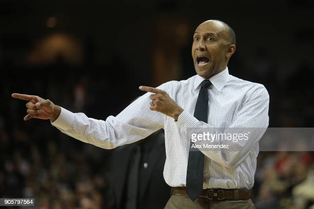 Head coach Johnny Dawkins of the UCF Knights argues with a referee during a NCAA basketball game against the Cincinnati Bearcats at the CFE Arena on...