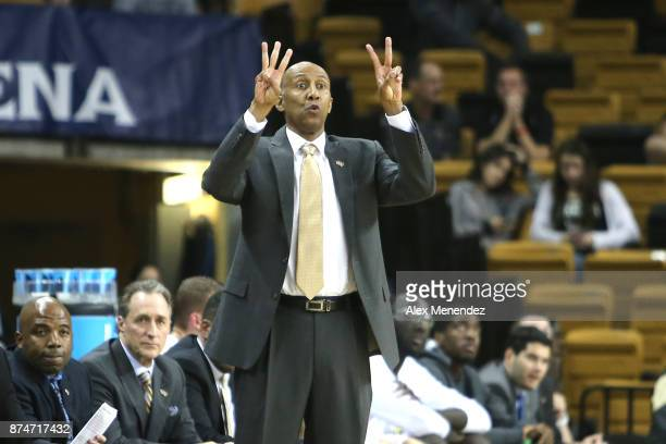 Head coach Johnny Dawkins of the UCF Knights gives instructions from the sideline during a NCAA basketball game against the GardnerWebb Runnin...