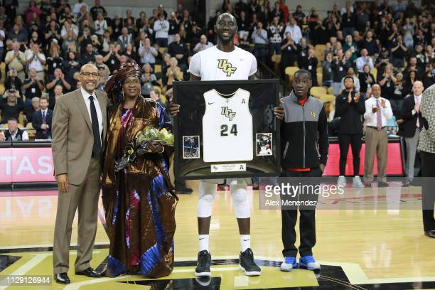 Head coach Johnny Dawkins of the UCF Knights Mariane Sene Tacko Fall of the UCF Knights and his brother Fallou Fall are seen during an NCAA...
