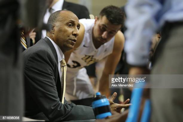 Head coach Johnny Dawkins of the UCF Knights talks in the huddle during a NCAA basketball game against the GardnerWebb Runnin Bulldogs at the CFE...