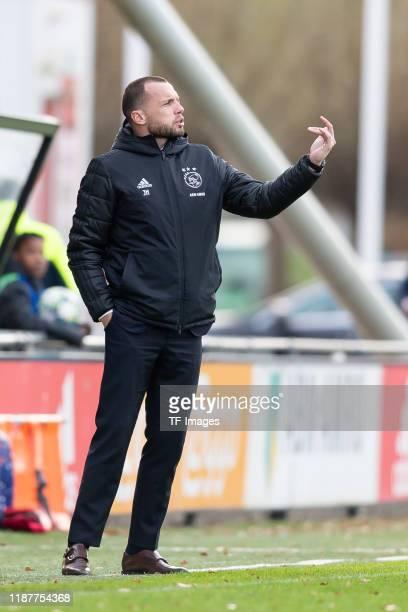 head coach Johnny Heitinga of Ajax Amsterdam U19 gestures during the UEFA Youth League match between Ajax Amsterdam U19 and FC Valencia U19 on...