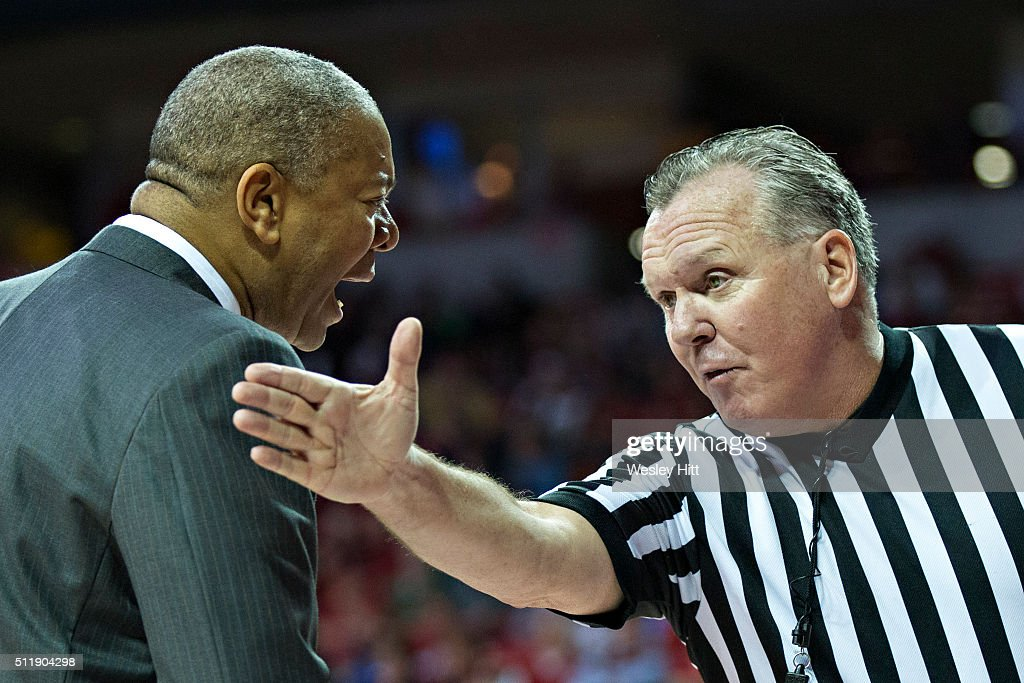 Head Coach Johnny Jones of the LSU Tigers argues with a referee during a game against the Arkansas Razorbacks at Bud Walton Arena on February 23, 2016 in Fayetteville, Arkansas. The Razorbacks defeated the Tigers 85-65,
