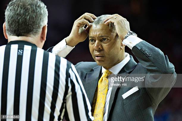 Head Coach Johnny Jones of the LSU Tigers talks with a referee during a game against the Arkansas Razorbacks at Bud Walton Arena on February 23 2016...