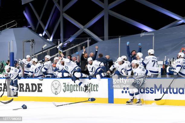 Head coach Jon Cooper and the Tampa Bay Lightning celebrate defeating the Dallas Stars 2-0 in Game Six of the NHL Stanley Cup Final to win the best...