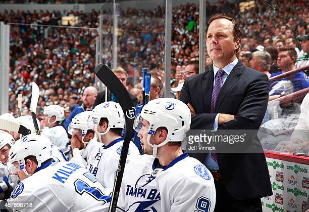 Head coach Jon Cooper of the Tampa Bay Lightning looks on from the bench during their NHL game against theVancouver Canucks at Rogers Arena October...