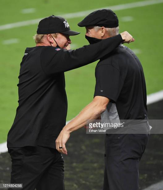Head coach Jon Gruden and general manager Mike Mayock of the Las Vegas Raiders celebrate on the field after the Raiders defeated the New Orleans...