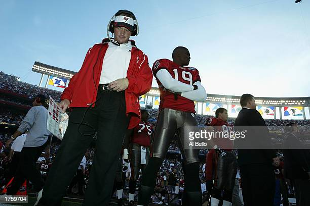Head coach Jon Gruden and wide receiver Keyshawn Johnson of the Tampa Bay Buccaneers stand on the field before the start of Super Bowl XXXVII against...