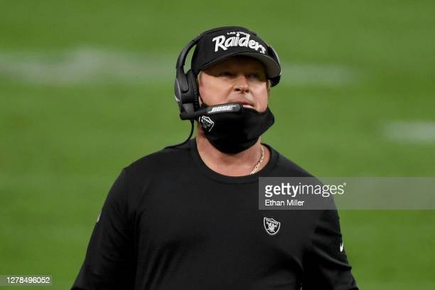 Head coach Jon Gruden of the Las Vegas Raiders wears a protective face mask incorrectly on the sideline against the Buffalo Bills during the fourth...