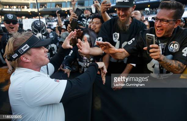 Head coach Jon Gruden of the Oakland Raiders celebrates with fans after a win against the Detroit Lions at RingCentral Coliseum on November 03 2019...