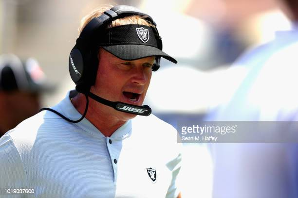 Head coach Jon Gruden of the Oakland Raiders coaches from the sideline during the first half of a preseason game against the Los Angeles Rams at Los...
