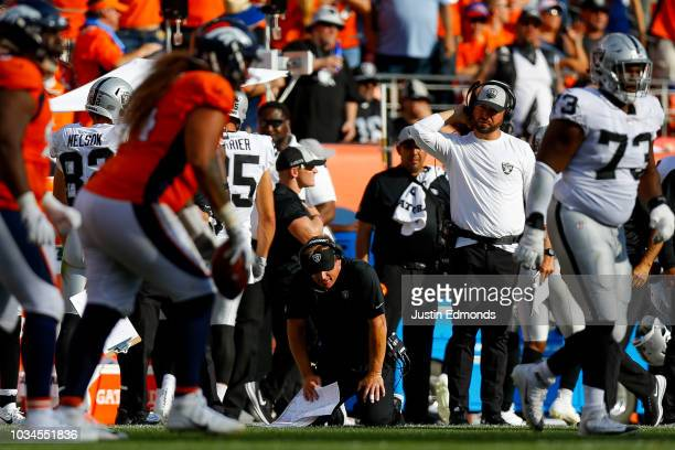 Head coach Jon Gruden of the Oakland Raiders drops to his knees as he reacts after the Oakland Raiders failed to convert a fourth down in the fourth...