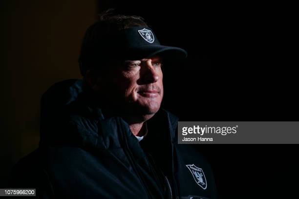 Head coach Jon Gruden of the Oakland Raiders walks through the tunnel to the field prior to the game against the Kansas City Chiefs at Arrowhead...