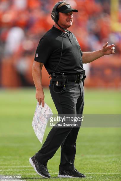 Head coach Jon Gruden of the Oakland Raiders works near the sideline during a game against the Denver Broncos at Broncos Stadium at Mile High on...