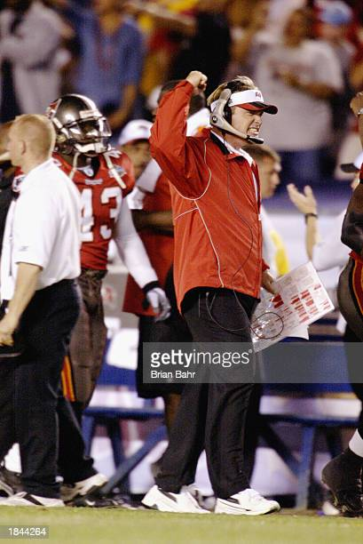 Head coach Jon Gruden of the Tampa Bay Buccaneers celebrates after a play against the Oakland Raiders during Super Bowl XXXVII on January 26 2003 at...