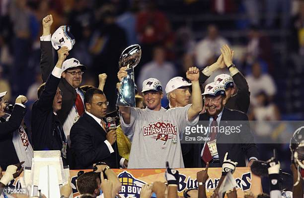 Head coach Jon Gruden of the Tampa Bay Buccaneers holds aloft the Lombardi Trophy as he celebrates after the victory over the Oakland Raiders in...