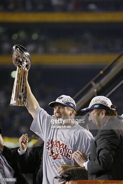 Head coach Jon Gruden of the Tampa Bay Buccaneers holds aloft the Vince Lombardi Trophy after defeating the Oakland Raiders in Super Bowl XXXVII at...