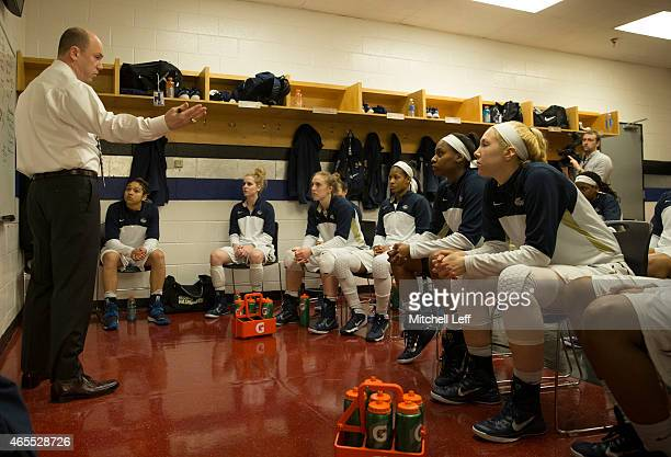 Head coach Jonathan Tsipis of the George Washington Colonials talks to his team in the locker room prior to the game against the Fordham Rams in the...