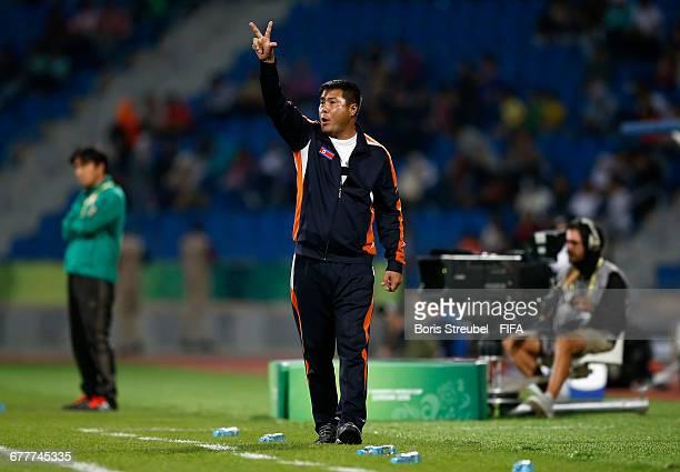 Head coach Jong Bok Sin of Korea DVR gestures during the FIFA U17 Women's World Cup Finale match between Korea DPR and Japan at Amman International...
