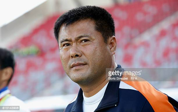 Head coach Jong Bok Sin of Korea DVR looks on prior to the FIFA U17 Women's World Cup Semi Final match between Venezuela and Korea DPR at King...