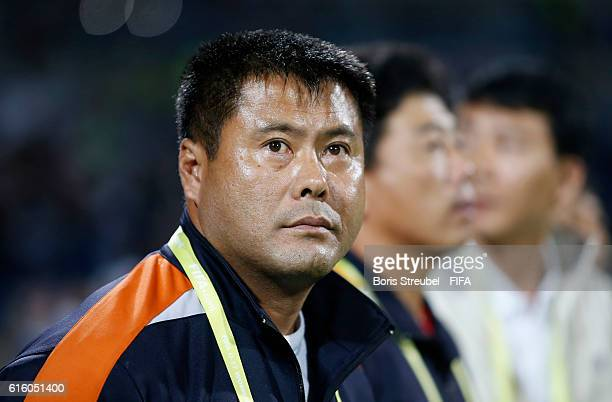 Head coach Jong Bok Sin of Korea DVR looks on prior to the FIFA U17 Women's World Cup Finale match between Korea DPR and Japan at Amman International...