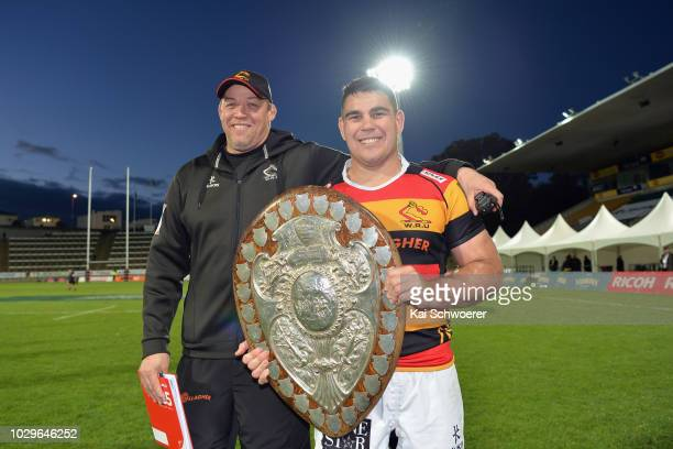 Head Coach Jono Gibbes of Waikato and captain Dwayne Sweeney of Waikato pose with the Ranfurly Shield after their win in the round four Mitre 10 Cup...
