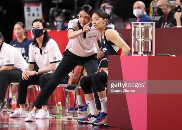 Head coach Jooweon Chun of Team South Korea talks with Jihyun Shin against Canada during the first half of a Women's Preliminary Round Group A game...